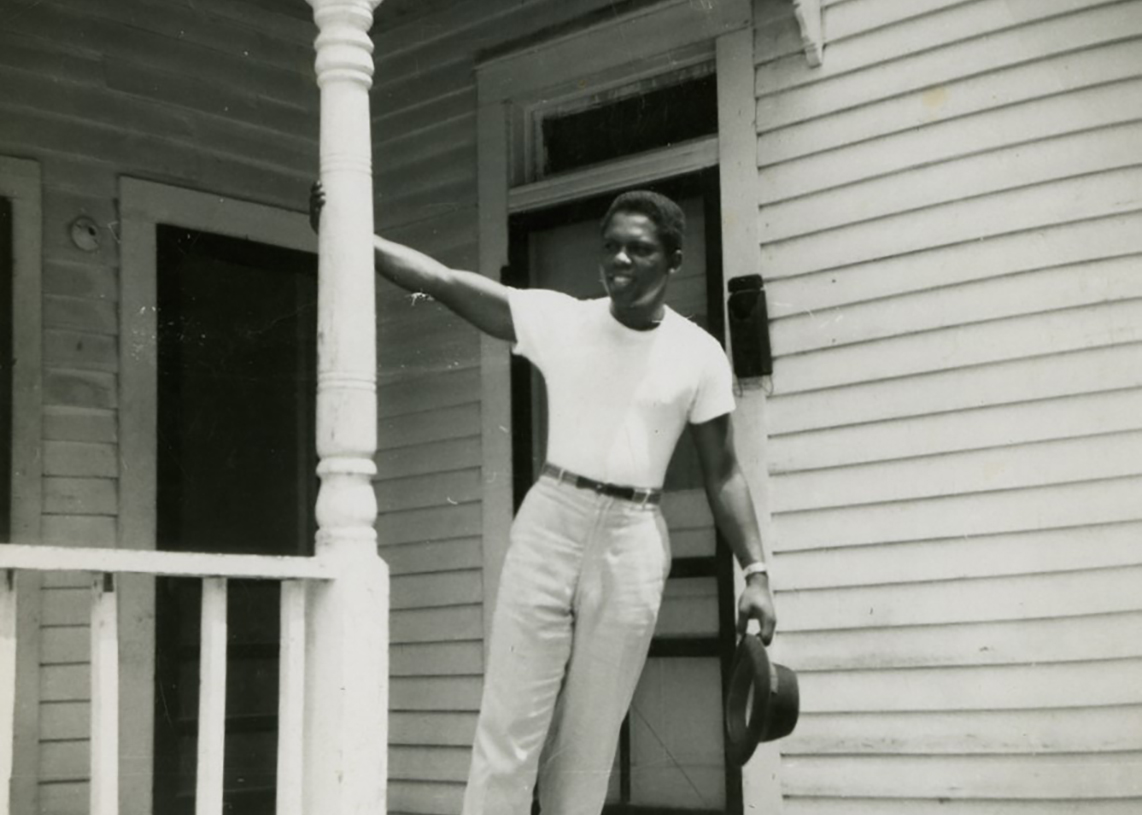 Hardy Anderson on a porch in Freedmen's Town
